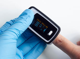 Doctor wearing blue nitrile exam gloves