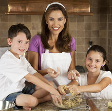 Michelle baking with Noel and Vincent