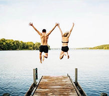 couple jumping in from dock first social