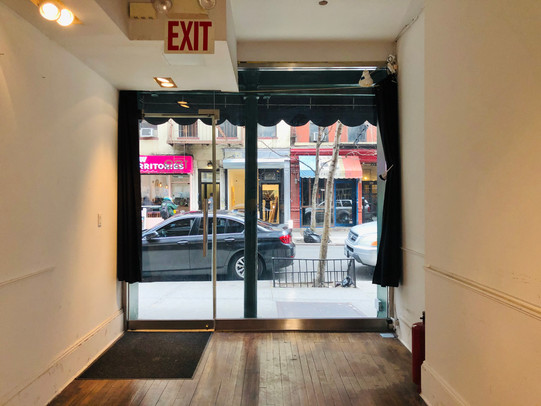 Floor to ceiling glass storefront with black out option