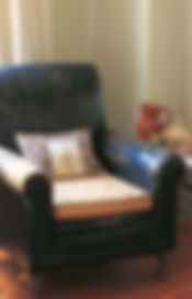 Shabby Chic Leather Chair Staged in Cozy conversation area
