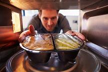 bigstock-Man-microwave-Dinner-Into-Mic-7