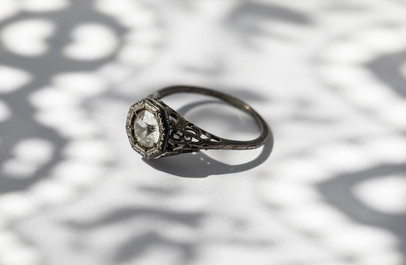 One of Zita's grandsons asked if I found the diamond ring that she hid around the house for safekeeping. Last known hiding spot was a flour sack. She's been dead 37 years and the ring is still hidden.   A ring found in Zita's belongings (We don't believe it's the ring she kept hidden).
