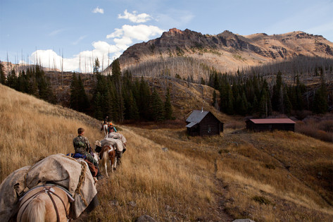 To get away from other hunters, the group rides about 1.5 hours into northwestern Colorado's Flat Tops Wilderness before setting up camp.