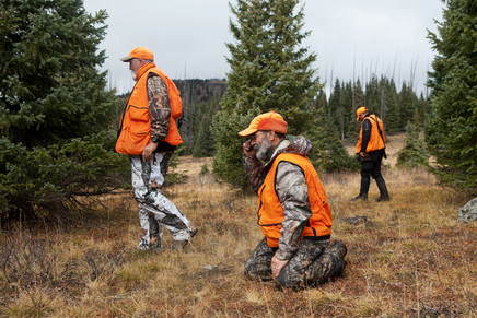 The group looking for blood  on the ground to track an injured elk.  A difficult task without snow on the ground.