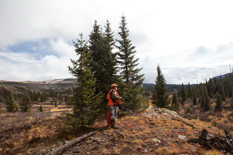 """""""For a true hunter, it's about the hunt,"""" says Hal Coombs, who uses a monocular to scout his surroundings for elk. """"The icing on the cake is to have meat for the winter."""""""