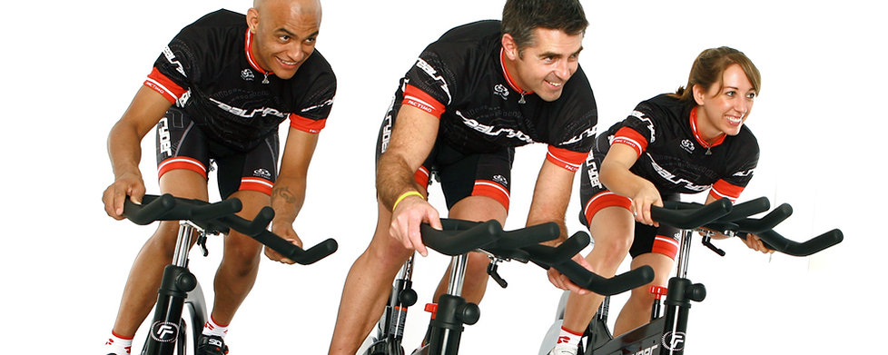 Three people leaning on RealRyder Bikes
