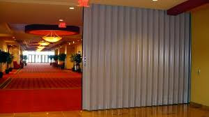 "These collapsing dividers are economical moveable dividers that can rapidly and proficiently separate a room. In any case, the wall doesn't flatten totally when the accordion is broadened, thus the name ""accordion"". These collapsing dividers cannot perform at the same level acoustically as the flat wall movable wall partitions but are less expensive."