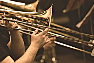 Hands of man playing the trombone