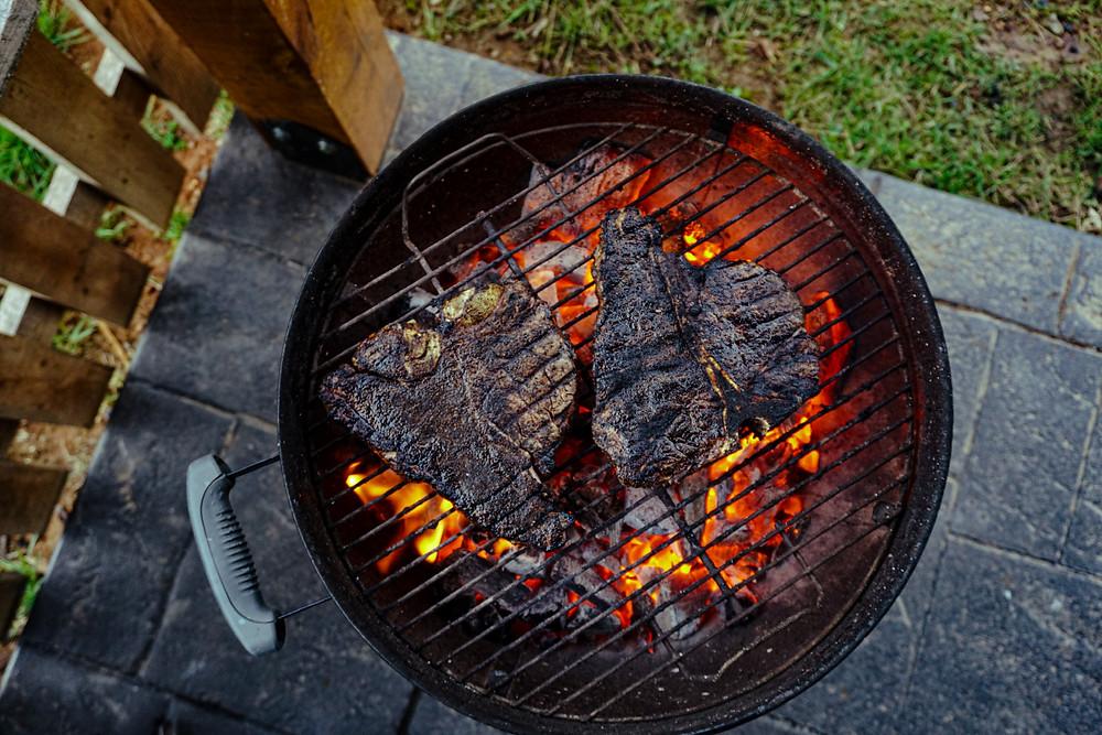 T-bone steak grilled on royal oak charcoal, Weber charcoal grills, lump charcoal