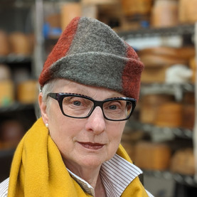 Beth sporting a creased handmade felt hat by Jean Hicks