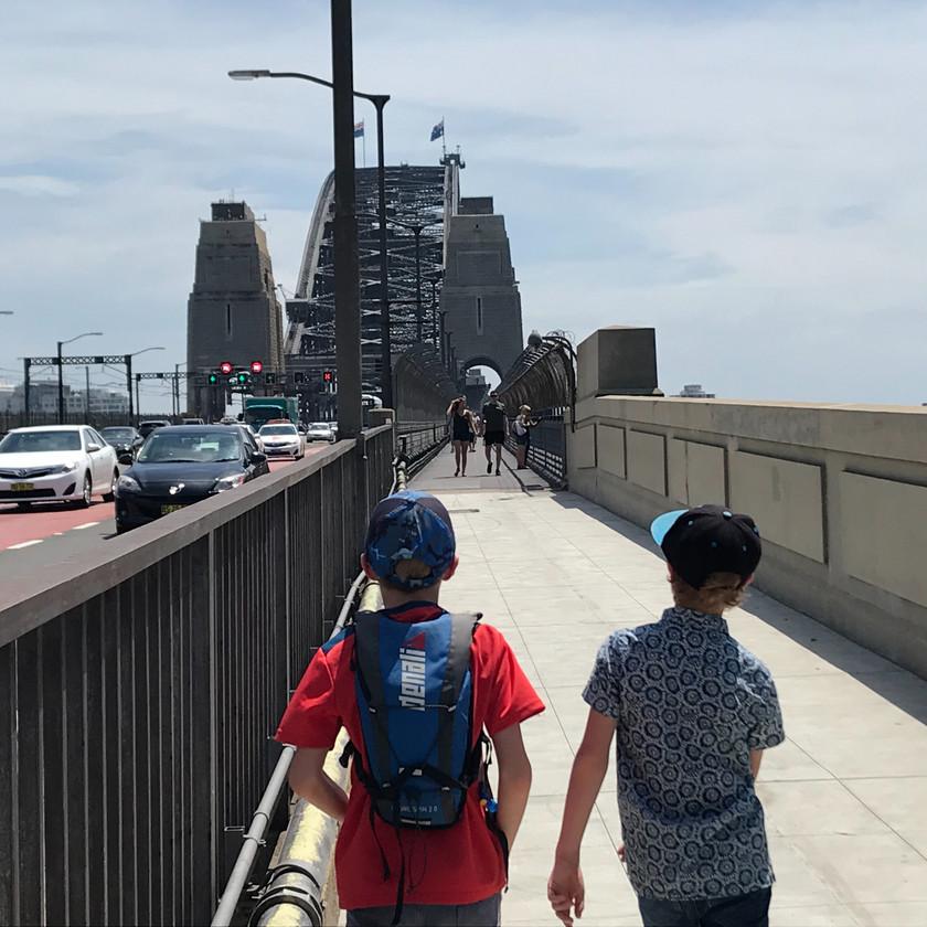 boys walking over harbour bridge