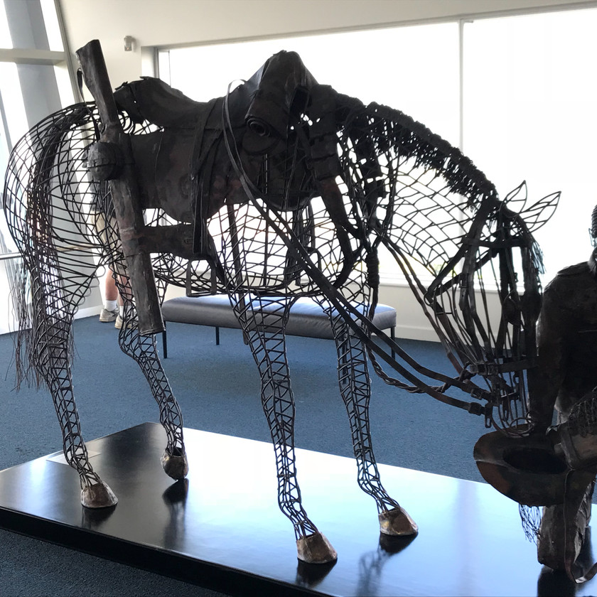 wire sculpture of horse and soldier