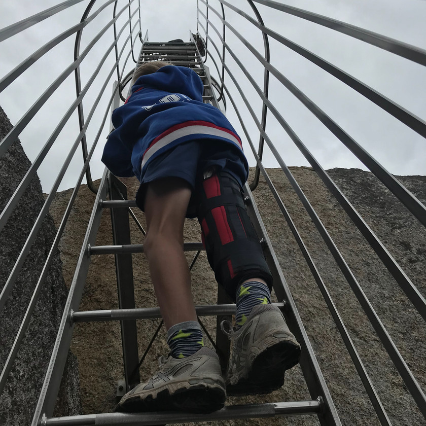 ollie negotiating the ladder to the skywalk