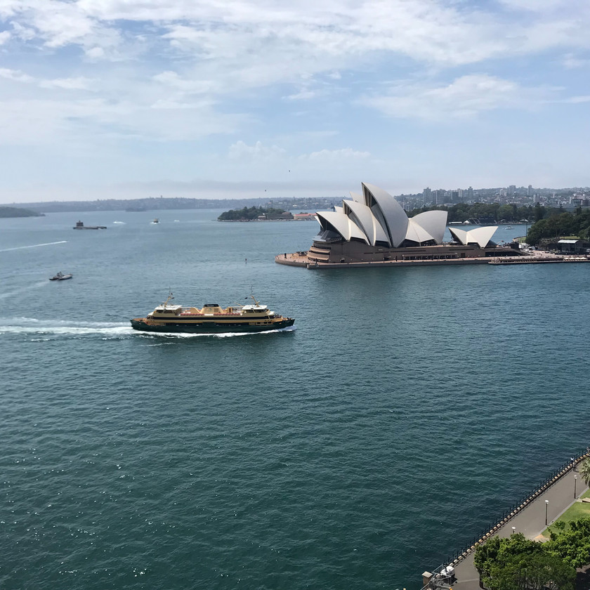 view from harbour bridge of ferry and sydney opera house