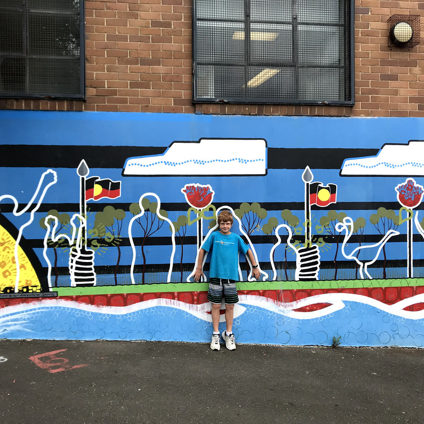 chase embedding himself into aboriginal mural
