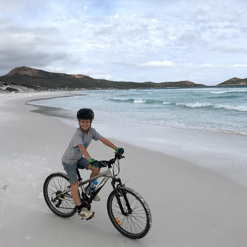 Chase riding bike on lucky bay beach