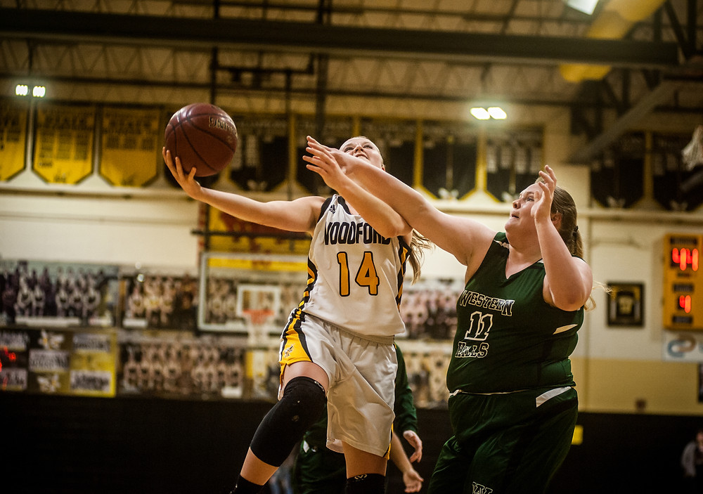 WCHS SOPHOMORE ABBIE HUDSON avoids a Western Hills defender during the Lady Jackets win on  Feb. 1 at the Hive. Hudson is averaging 9.7 ppg this season. (Photo by Bill Caine)