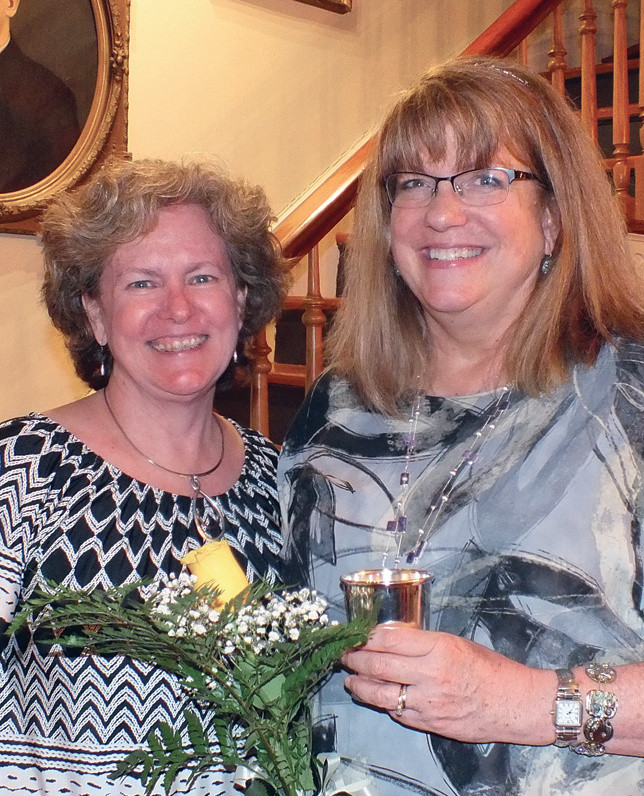 """Amy Perry, right, was presented the the Midway Woman's Club """"2018 Club Woman of the Year"""" award.  Perry was selected for her tireless work and dedication during her first year  membership year. Pictured with Perry is Genie Graf, Midway Woman's Club president. (Photo submitted)"""