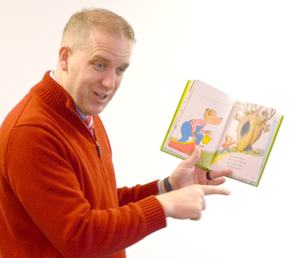 JASON McALLISTER reads to students for Read Across America Day at Southside Elementary School in 2017. McAllister's leaving Southside after this school year to become chief academic officer for Mercer County Schools, he said. (File photo by Bob Vlach)