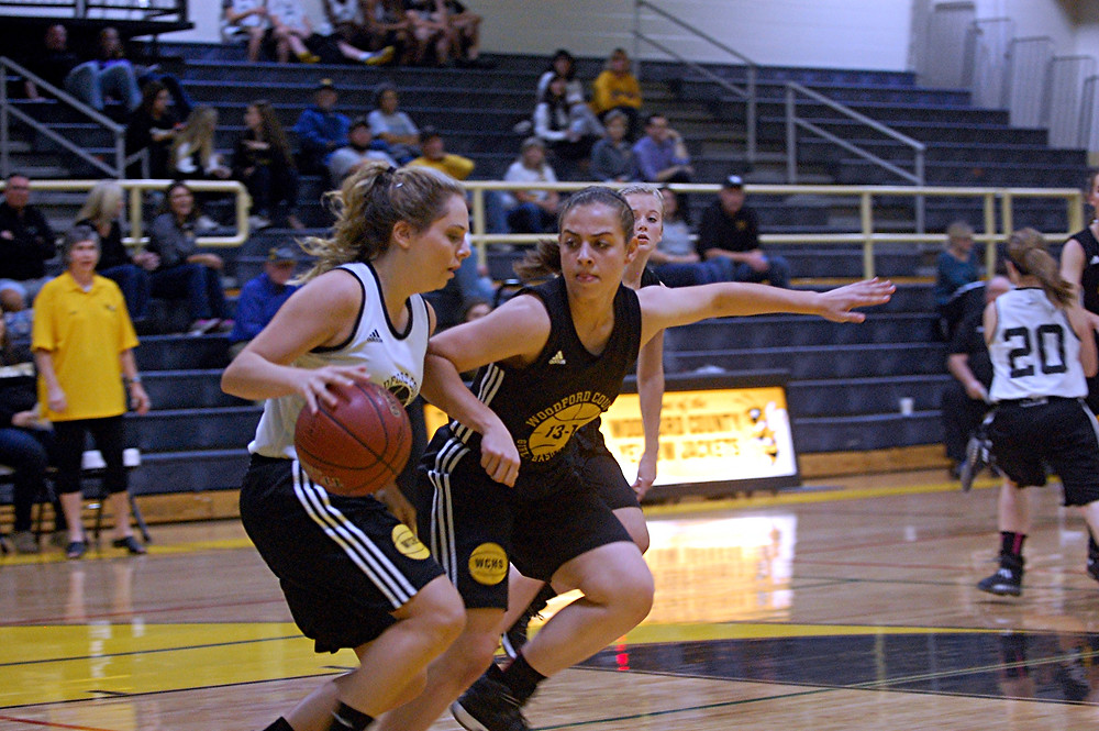SCENES FROM the WCHS girls' basketball scrimmage during Jacket Madness on Friday, Nov.  18 in The Hive. . Peyton Rose, dark jersey, will not only be known for her offence but her defense as well. (Photo by Rick Capone)