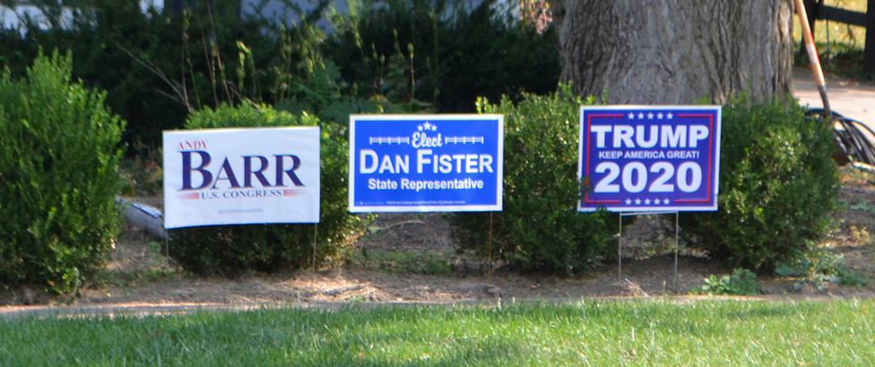 YARD SIGNS FOR REPUBLICAN CANDIDATES are pictured in front of a South Main Street residence in Versailles. Busy streets are a popular place for yard signs. (Photo by Bob Vlach)