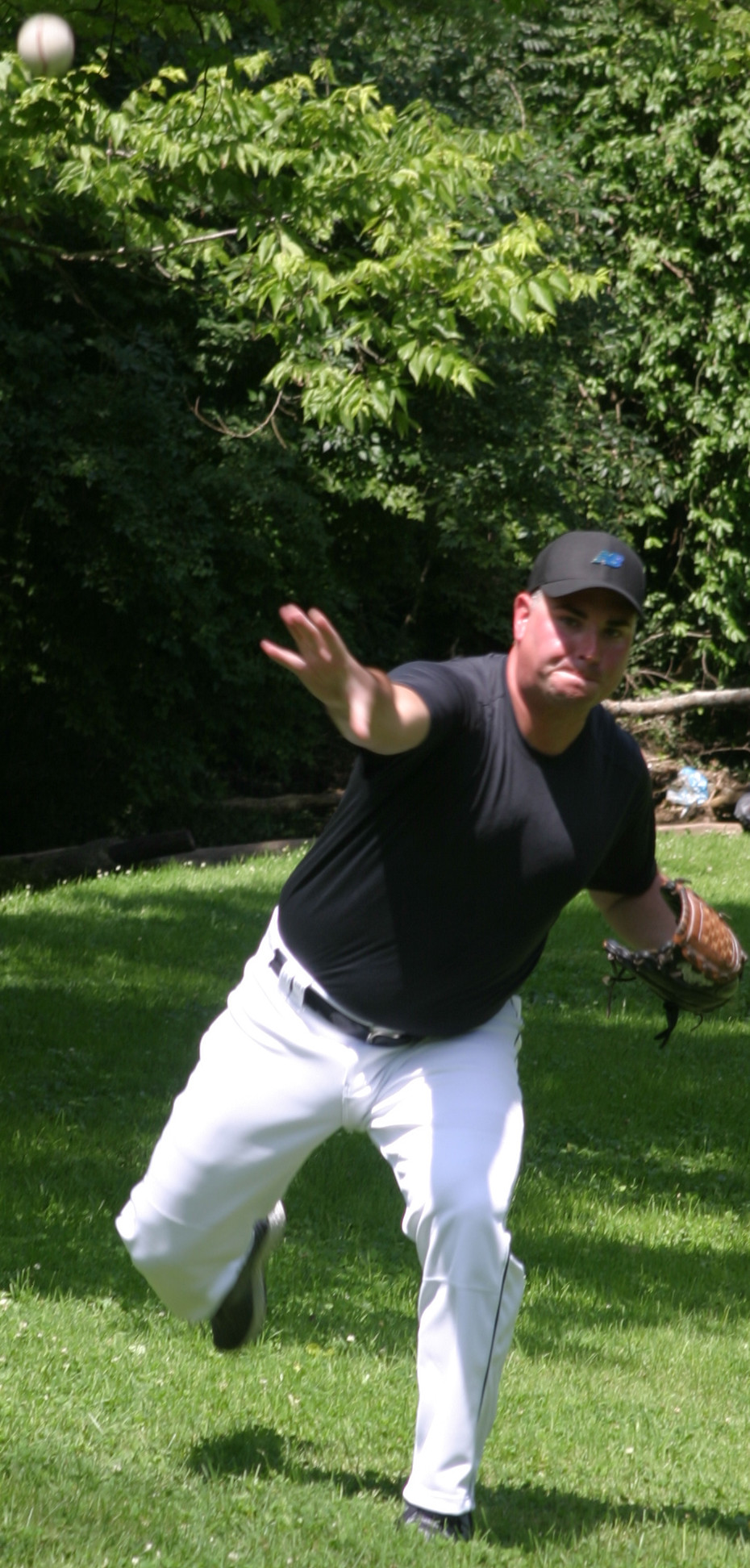 """TERRELL RENFRO took it easy during a Monday pitch-and-catch session at Big Spring Park, which may have saved the photographer a broken lens or bruised kneecap. Of his knuckleball, the 2003 WCHS graduate said, """"I have that specialty pitch - that always increases your chances."""" (Photo by John McGary)"""
