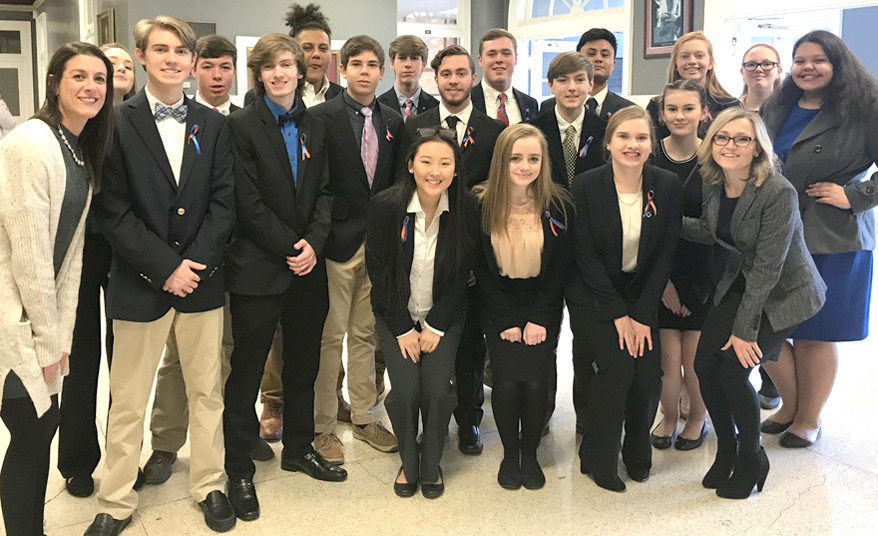 DECA CLUB students from Woodford County High School earned multiple awards for their business and marketing knowledge at the DECA Regional Conference. From left, are (front row) Lily Stewart, Lauren Moore, Emma Wesley and advisor Heather Schuerman; (middle) advisor Blair Hicks, Hayden Rankin, Alex Sowder, Walter Horn, Chance Burnett, Greyson Rankin, Keelie McClellan and Kiera Gill; (back) Lauren Miller, Drew Blaydes, Chris Ramirez, Ian Davis, Brody McCoun, Irvin Flores Sanchez, Katherine Kelly and Emilyn Williams. (Photo submitted)