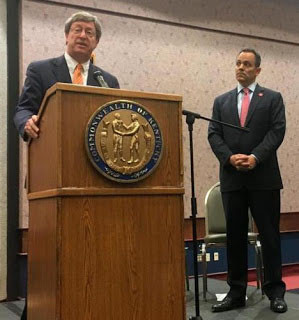 At a May 30 news conference in Louisville, Ben Chandler, president and CEO of the Foundation for a Healthy Kentucky, shared the stage with Gov. Matt Bevin to discuss the state's new Medicaid rules and how the foundation can help Medicaid recipients meet them. (Associated Press photo by Adam Beam)