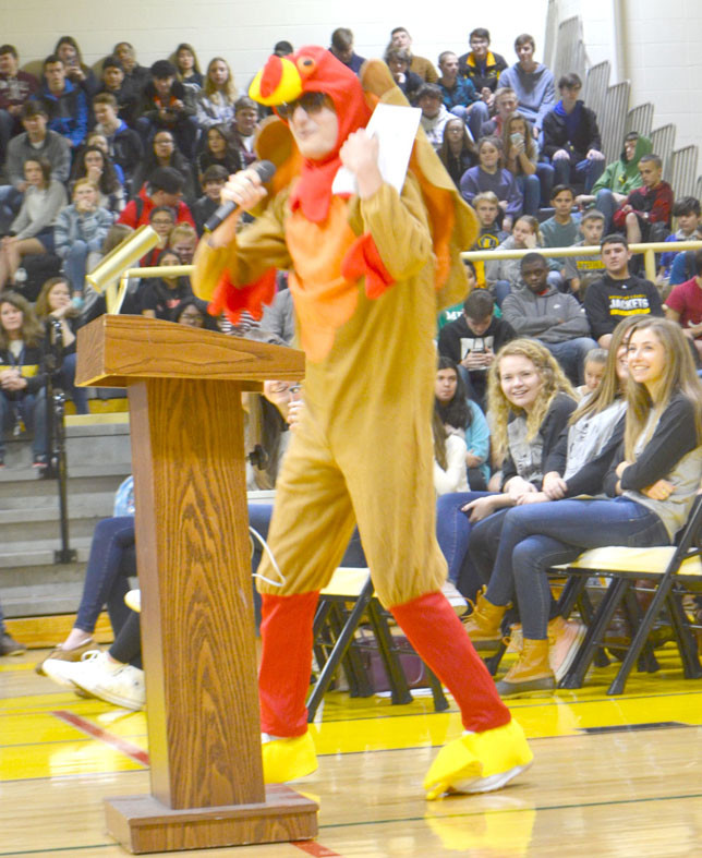 EDDIE LUNSFORD, a Woodford County High School senior, entertained his peers as a rapping turkey during his school's Thanksgiving Food Drive assembly Nov. 20. Eddie also won the assembly's annual turkey calling contest. (Photo by Bob Vlach)