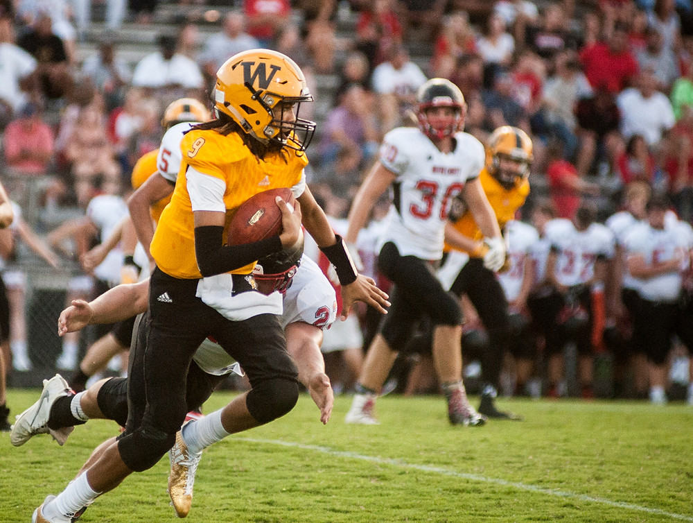 QUINTON TURNER escapes a diving Wayne County defender. (Photo by Bill Caine)
