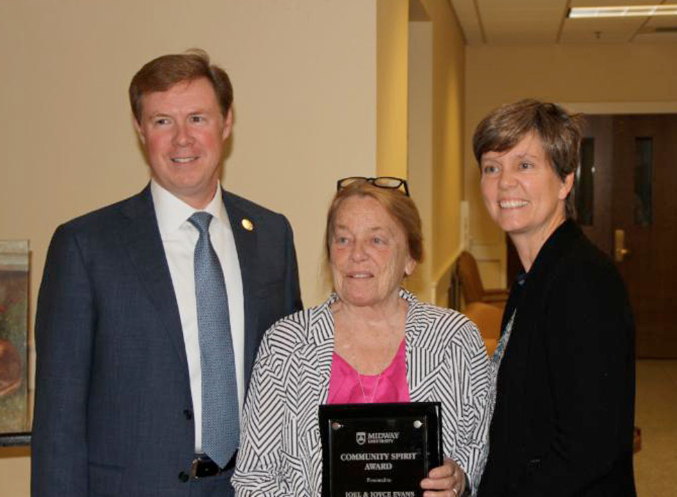 DR. JOHN P. MARSDEN, left, president of Midway University and Ellen D. Gregory, right, vice president of marketing and communications, Midway University, present the 2016 Community Spirit Award to Joyce Evans. (Photo submitted)