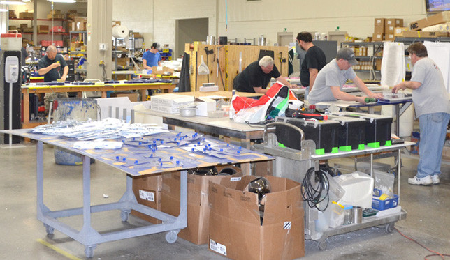 RUGGLES SIGN COMPANY relocated its family-owned business to a renovated manufacturing building formerly occupied by Kuhlman Electric, which closed its Versailles plant in 2009. (File photo by Bob Vlach)