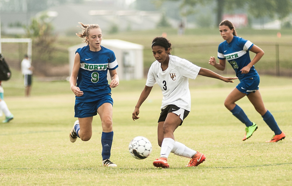 JASMINE COLLINS takes control of the ball at the Bluegrass State Games. (Photo by Bill Caine)