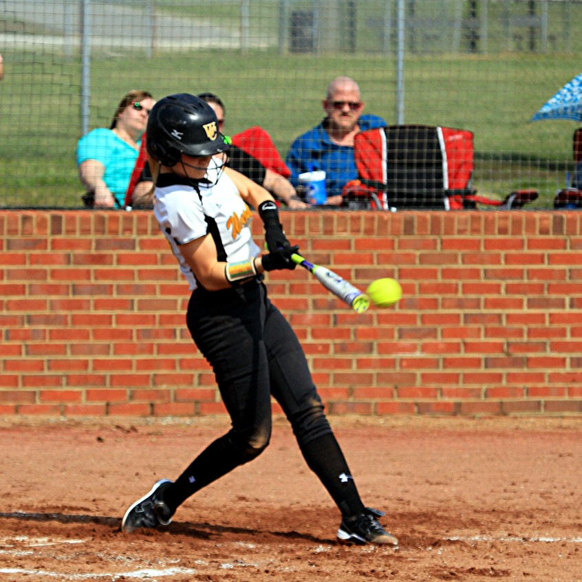 Caitlin Ferguson hit the ball hard on this at bat during Woodford's game against Assumption. (Photo by Steve Blake/multiexposures.com)