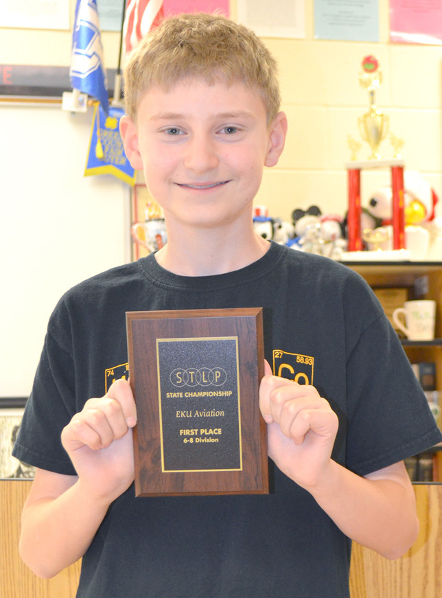 DALTON WELLS, a seventh-grader at Woodford County Middle School, won a first-place plaque in aviation at the state's Student Technology Leadership Program (STLP) championship in Lexington on March 30. (Photo by Bob Vlach)