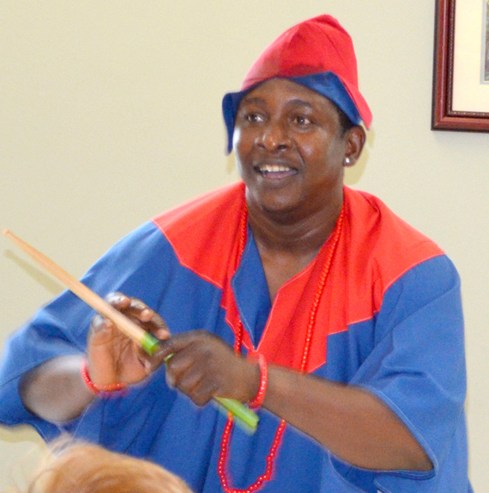 "BI-OKOTO artist Chukwudi Arogbotimi explained how people in Africa use drums as a means to communicate. ""Drums talk in Africa,"" he told those attending a luncheon sponsored by the Woodford County Library. (Photo by Bob Vlach)"