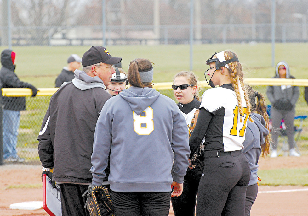 LES ANDERSON, left, the first-year head coach of the Lady Jackets, has a meeting during a game earlier in the season with his players. With the loss to East Carter, Anderson finishes the season with a 34-7 overall record, a 13-3 region record and a 7-1 district record. In addition, Anderson's team won its third straight 41st District title and its first 11th Region championship since 2006 with a win over powerhouse Scott County, a team that knocked them out of the region tournament the last few years. (Photo by Rick Capone)