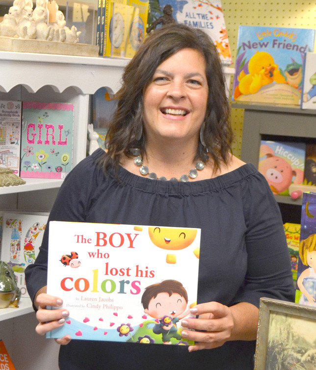 """LAUREN JACOBS wrote and self-published a book about her tenacity and her son Caleb's determination to """"find his colors again."""" While Jacobs did not have fairy wings and a magic wand like the fictional mother did in """"The Boy who lost his colors,"""" she did use """"all the tricks she could find to teach her little boy."""" (Photo by Bob Vlach)"""