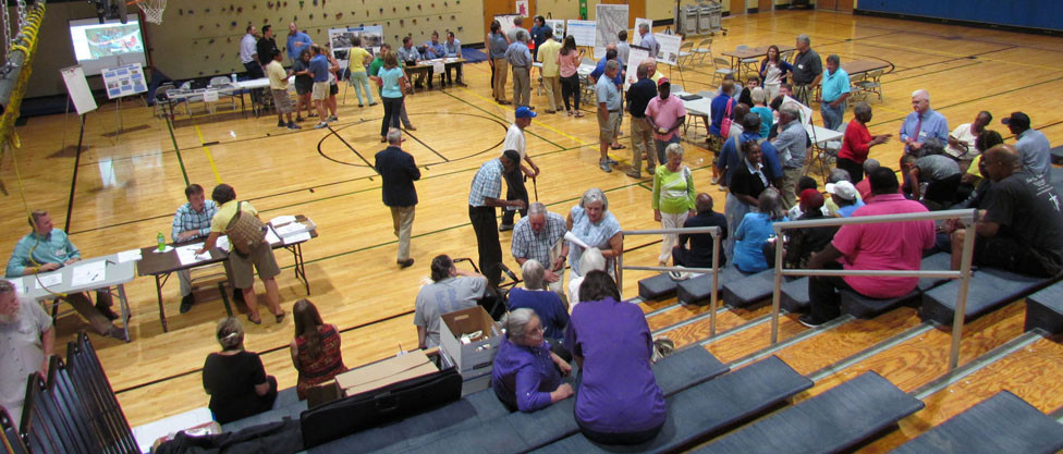 ABOUT 75 PEOPLE attended a public meeting about the Weisenberger Mill Bridge at Northside Elementary last Thursday, Aug. 9. The project engineer said if all goes well, the one-lane bridge could reopen as early as this time next year. That's not soon enough for most of the attendees, who say they've been inconvenienced on a regular basis since the bridge was closed for safety reasons in July 2016. (Photo by John McGary)