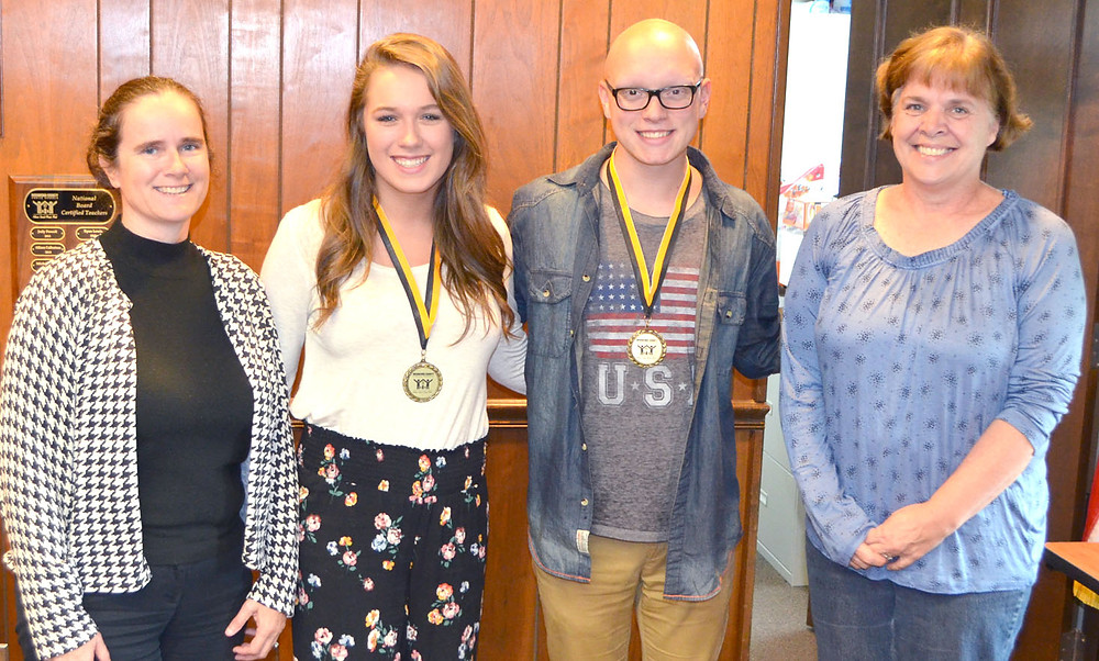 GSP PARTICIPANTS Turner Reynolds and Jared Christian talked about their experiences in the five-week residential program during the Woodford County Board of Education's meeting on Monday, Aug. 28. From left are Board Member Sherri Springate, Turner, Jared, and board Vice Chair Debby Edelen. (Photo by Bob Vlach)