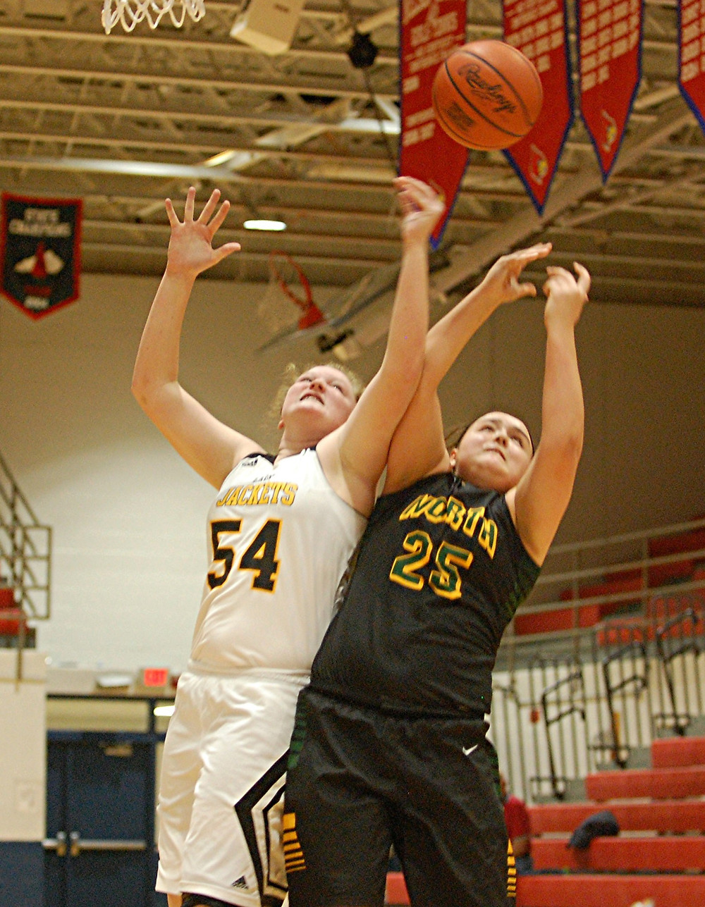 DELNEY ENLOW, No. 54, will be a player to watch on the Woodford County High School girls' basketball team. A freshman, Enlow will be counted on to pull down rebounds and score points under the basket for the Lady Jackets this season. (File photo by Rick Capone)