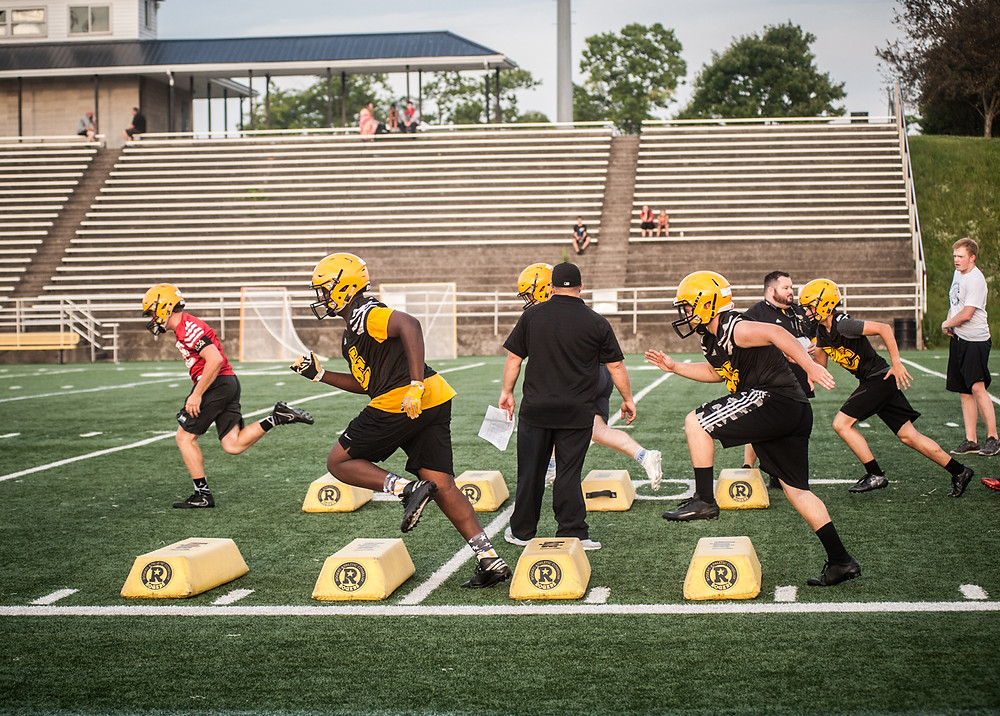 THE WOODFORD COUNTY HIGH SCHOOL football team prepares for the 2017 season with drills at Community Stadium. The season begins next month. (Photo by Bill Caine Photography www.billcaine.com)