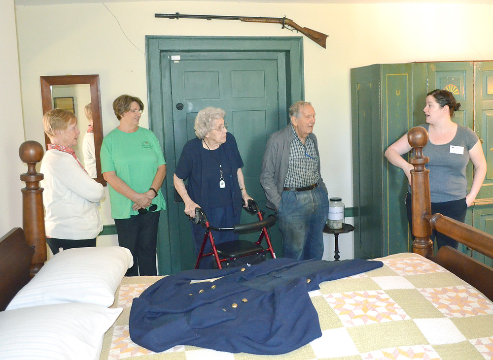 RESIDENTS OF DAISY HILL Senior Living Community went on a field trip to the Jack Jouett House Historic Site on Craigs Creek Road last Friday, Sept. 23. From left are Peggy Gay, activities director Pat Fleming, Mary Churchill and Bob Burkich listening to Jill Roseberry, executive director of the Jouett House. (Photo by Bob Vlach)