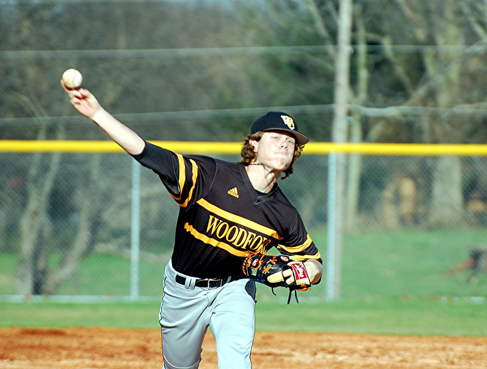 """NATE BEAVERS got the start for the Woodford County High School baseball team in its season opener against Scott County in Georgetown on Tuesday, March 15, and made the most of it. He pitched five strong innings and had six strikeouts, while giving up six hits, three runs and no walks in his five innings on the mound to help the Bat Jackets score a 10-4 victory. According to first-year Woodford head coach Paul Patterson, """"When Beavers is good, we're really good.""""(Photo by Rick Capone)"""