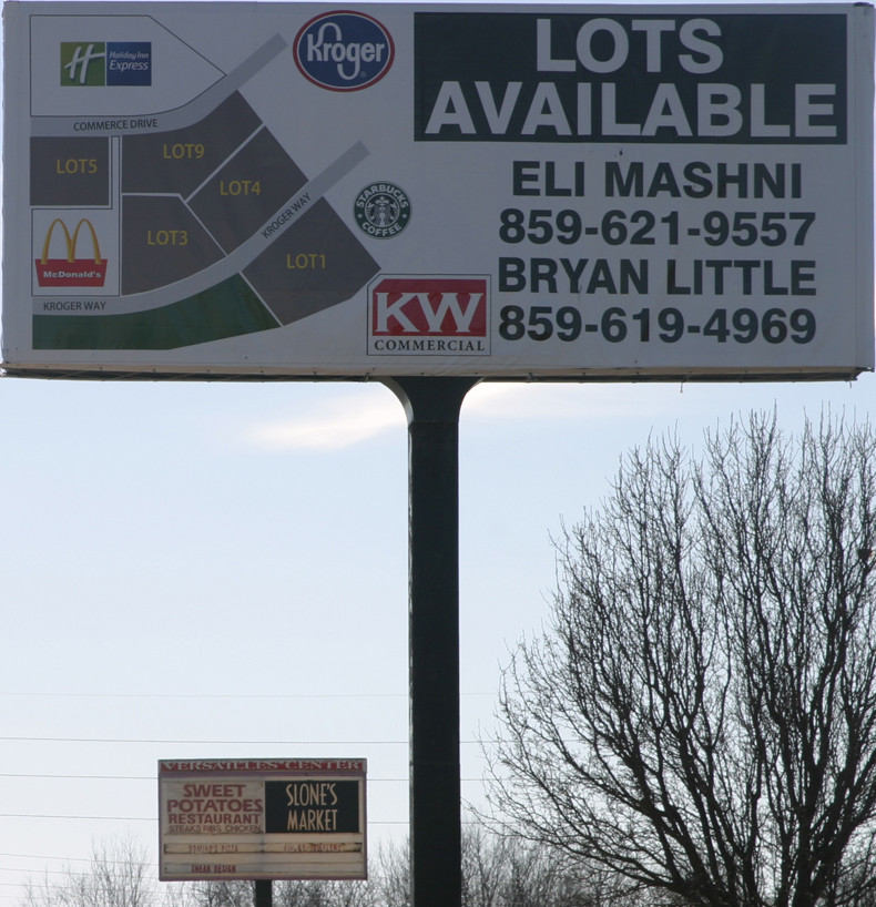 SIGN OF THE TIMES: This new sign at the front of the old Versailles Center shows how the Versailles Land Group has divided the lots of the property, for which they paid $1.08 million. (Photo by John McGary)