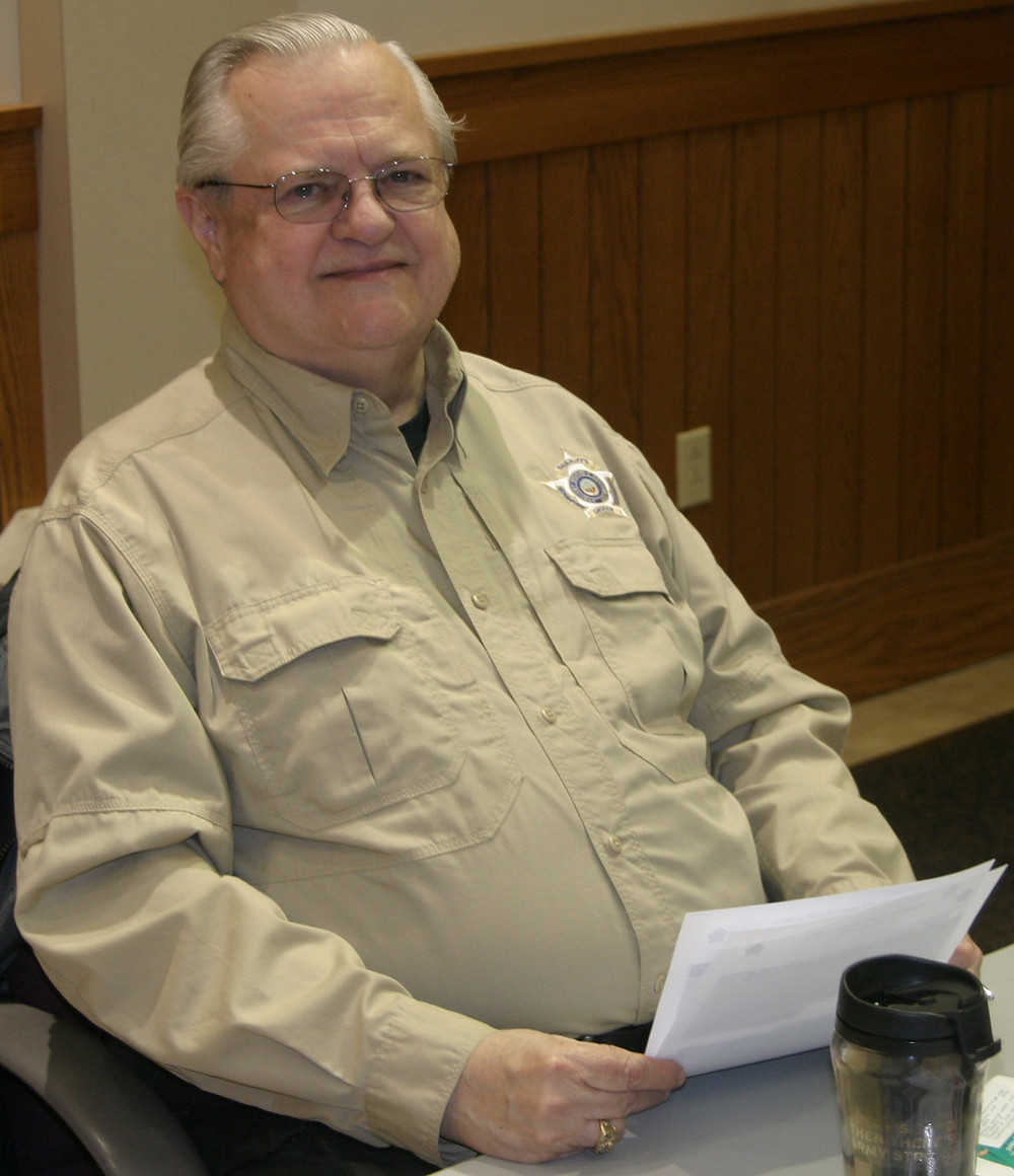 """CHARLIE BEAGLE'S last day as a court security officer at the Woodford Courthouse Annex was Wednesday. """"Overall, it's been a great journey,"""" said Beagle, who also spent three years in the Army and 30 years as a corrections officer at FMC Lexington. (Photo by John McGary)"""