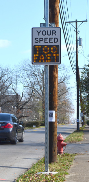 RADAR SIGNS on Montgomery Avenue remind motorists when they're going too fast on the neighborhood street, which has a posted speed limit of 25 miles per hour. (Photo by Bob Vlach)