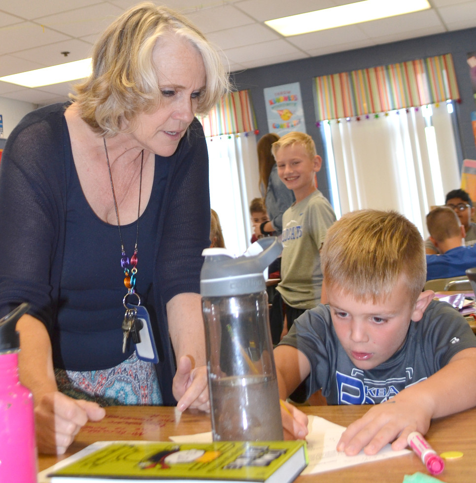 """KATHY GOODRICH says it's a joy to facilitate her students' learning. """"The more I can facilitate a love for learning … the better I am,"""" says Goodrich. She's pictured with Grayson Fugate, one of her fifth-grade students. (Photo by Bob Vlach)"""