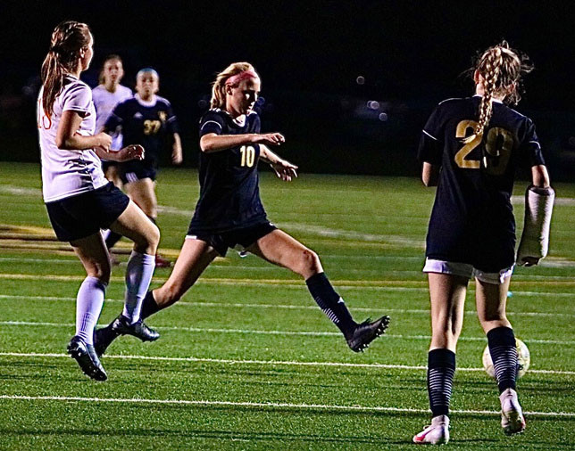 SENIORS Killian Morrison, center, and Abigail Wooten helped lead the Woodford County girls' soccer team to a 5-0 win over Bourbon County at Community Stadium Sept. 23. (Photo by Bryan Birch)